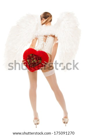 young blond woman in angel costume holding heart - stock photo