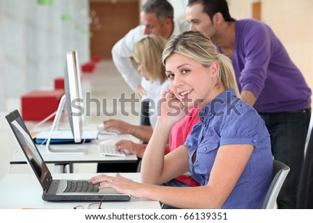 Young blond woman in business training - stock photo