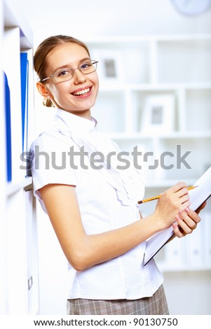 Young blond woman in business wear in office environment