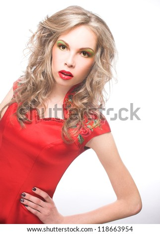Young blond woman in red dress