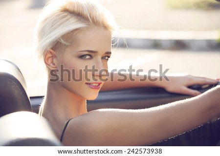 young blond woman in the car - stock photo