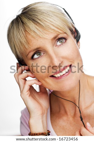 young blond woman listening mp3 player close up