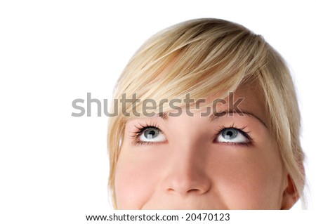young blond woman looking up on white- close up - stock photo