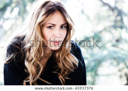 young blond woman outdoor autumn portrait