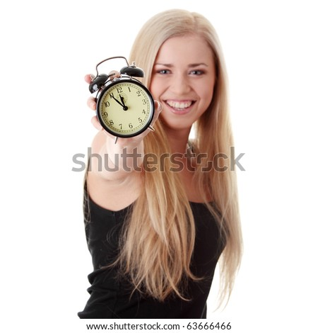 Young blond woman showing alarm clock, isolated on white