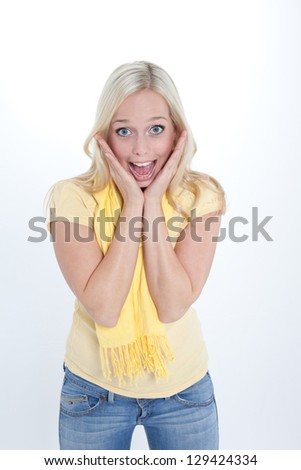 young blond woman shows a gesture of surprise/woman is surprised/young blond astonished woman
