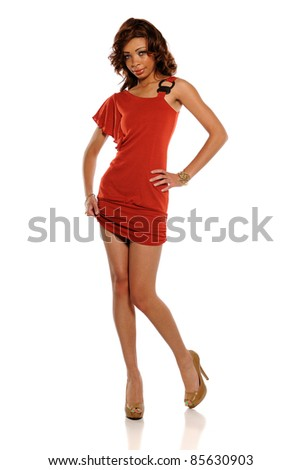 Young Blond Woman wearing a red dress isolated on a white background