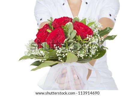 young blond woman with a bouquet of red roses - stock photo