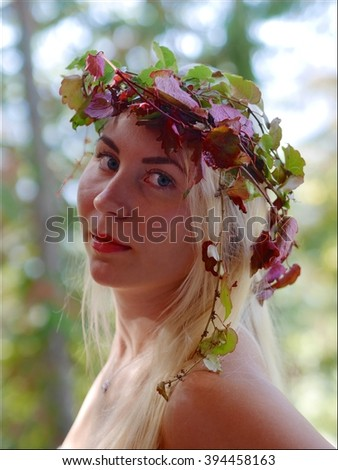 Young Blond Woman with Autumn Leaves on Head.  Halcyon Hot Springs, British Columbia, Canada.