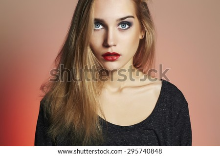 Young blond woman with blue eyes.Beautiful blonde Girl.Make-up and red lips - stock photo