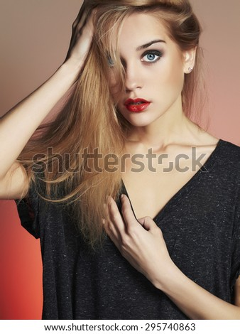 Young blond woman with blue eyes.Beautiful blonde Girl.Make-up and red lips