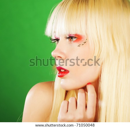 young blond woman with bright make-up - stock photo