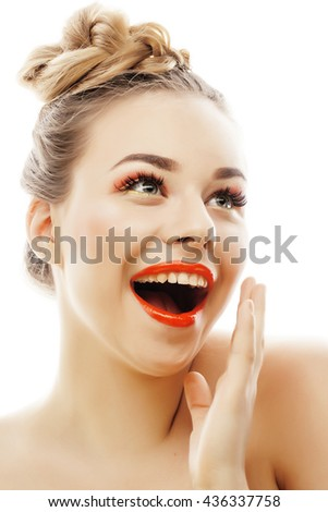 young blond woman with bright make up smiling pointing gesturing emotional isolated like doll lashes on white - stock photo