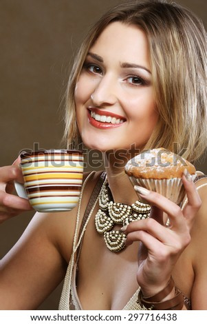 young blond woman with coffee and cookies. - stock photo
