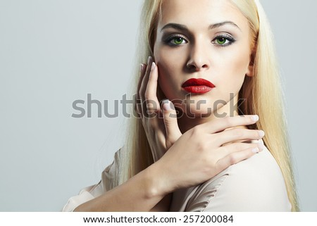 Young Blond woman with manicure.Beautiful model with make-up.red lips - stock photo