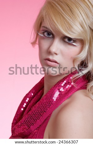 young blond woman with pink background