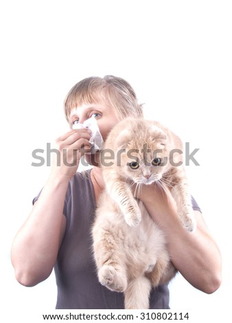 young blond woman with red cat in hands allergies sneezing isolated white - stock photo