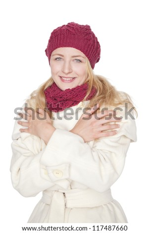 young blond woman with scarf and coat on a winter day - stock photo