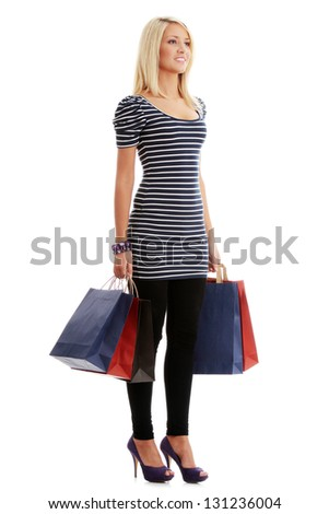 Young blond woman with shopping bags, isolated on white - stock photo