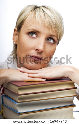 young blond woman with stack of books close up