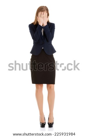 Young blonde beautiful desperate businesswoman - stock photo