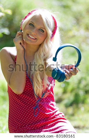 Young blonde beautiful girl and earphones