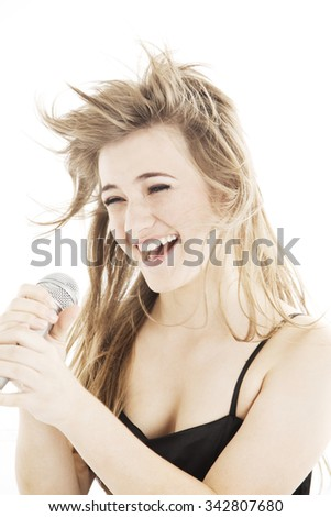 Young blonde beautiful teen woman singing with microphone isolated on white - stock photo
