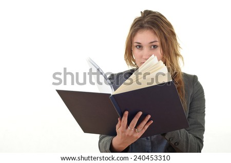 Young blonde beauty business woman reading book - stock photo
