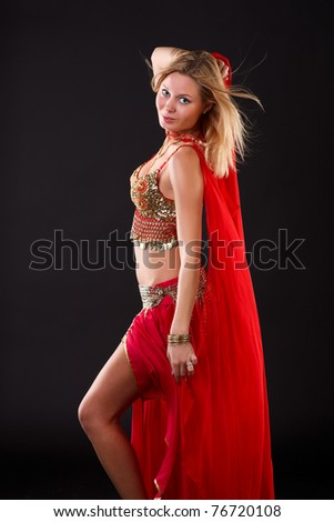 Young blonde belly dancer in red.