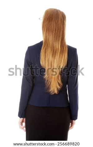 Young blonde businesswoman back view