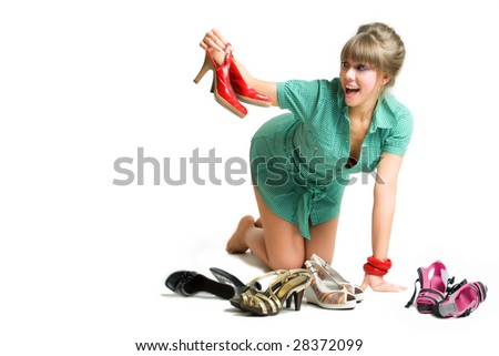 young blonde choosing her shoes, isolated over white