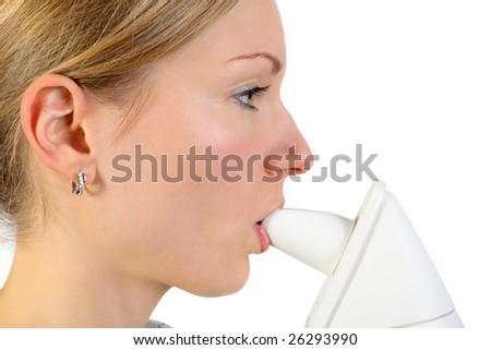 young blonde female using an inhalator to release her respiratory system