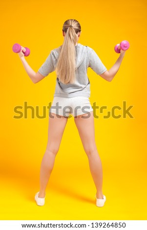 young blonde fitness woman - stock photo