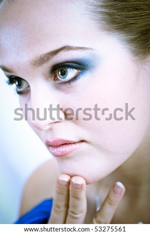 Young blonde girl with blue makeup - stock photo