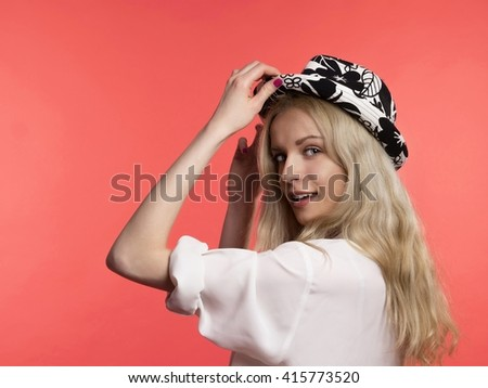 young blonde hair woman in hat on red background