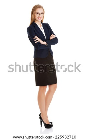 Young blonde happy businesswoman standing
