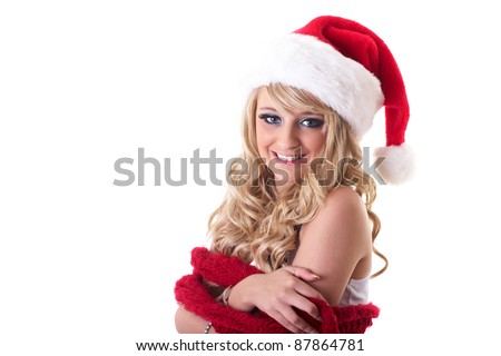 Young blonde happy girl in santa hat, isolated on white