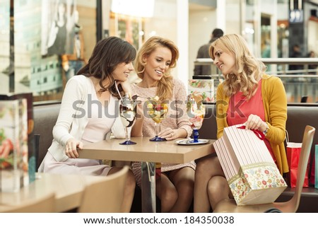 Young blonde lady presenting her brand new clothes - stock photo