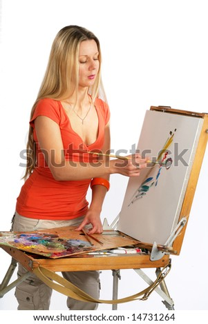 Young blonde long hair artist painting a canvas