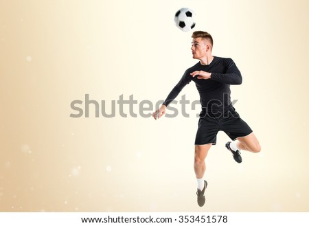 Young blonde man playing football - stock photo
