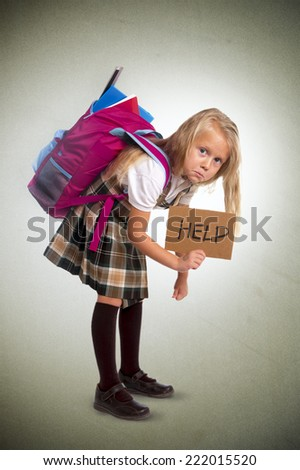 young blonde schoolgirl holding help sign carrying heavy backpack or school bag full causing stress and pain on back due to overweight isolated on grunge  background - stock photo