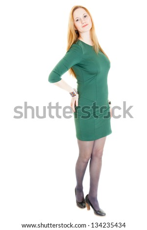 young blonde sexy woman wearing a green dress, black panti-tights and sandals - stock photo