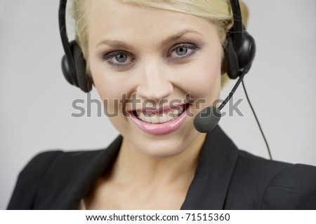 Young blonde telephonist woman