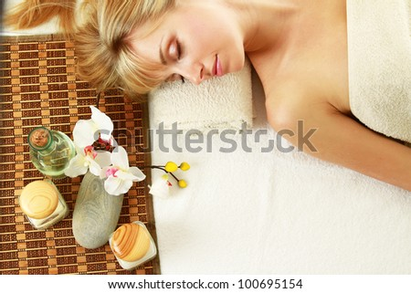 Young blonde woman at spa procedure, top view - stock photo