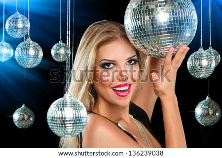Young blonde woman dancing at night disco club - stock photo