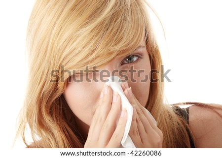 Young blonde woman having a cold close up isolated on white background - stock photo