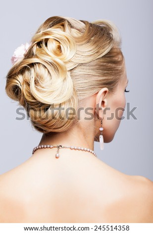 Young blonde woman head from back side - stock photo
