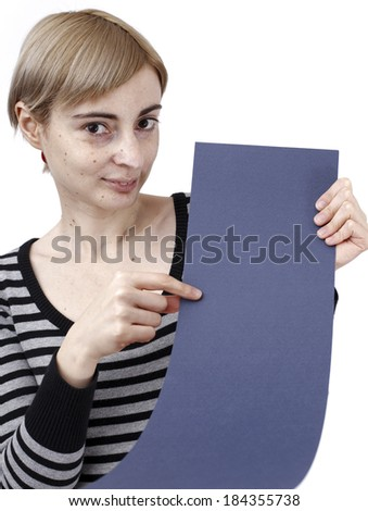 Young blonde woman holding a blank piece of paper. - stock photo