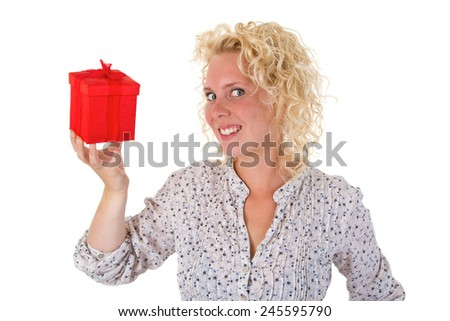 Young blonde woman holding a red gift in her hand - stock photo