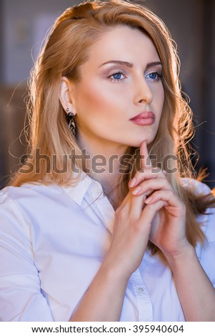 Young blonde woman in fashion blouse. High fashion look. Portrait of a fashionable model.Close up. Studio shot. - stock photo